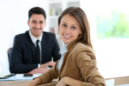 Woman meeting financial adviser for business project photo