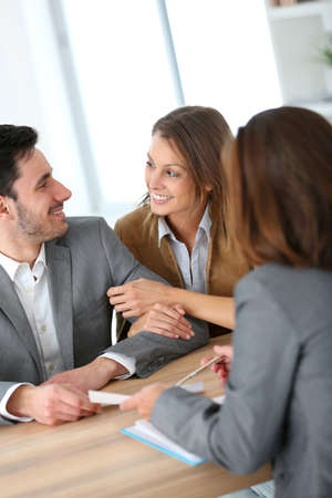 Couple meeting financial adviser for construction project photo