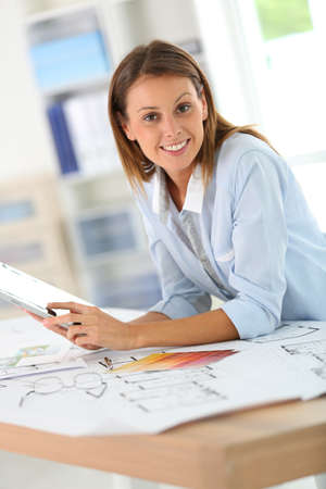 Woman architect working in office on project photo