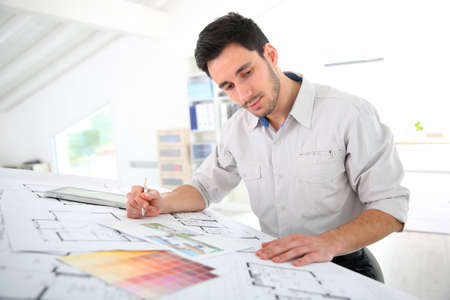 architect drawing: Architect in office drawing construction blueprint Stock Photo