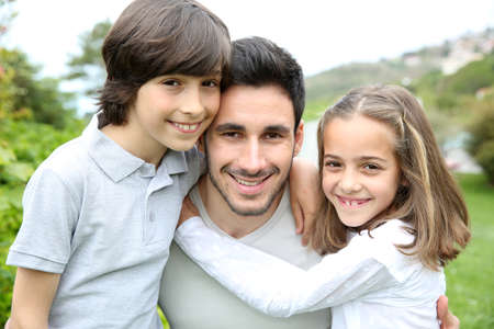 single parents: Portrait of young man with 2 kids