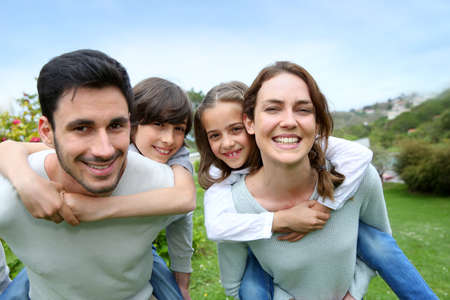 Happy family having fun in home garden Stock Photo