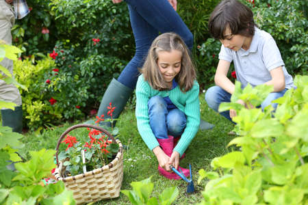 springtime: Kids gardening at home together in springtime Stock Photo