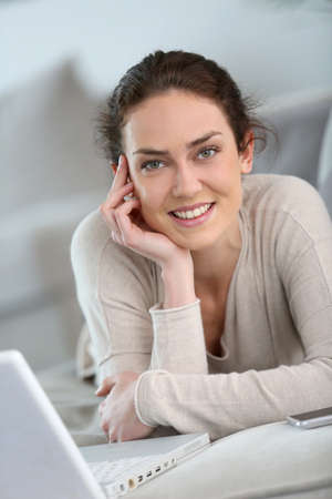 websurfing: Middle-aged woman at home websurfing with laptop Stock Photo