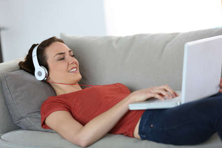 skype: Woman with headphones chating on internet