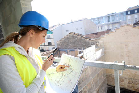 woman engineer: Woman engineer on building site checking construction