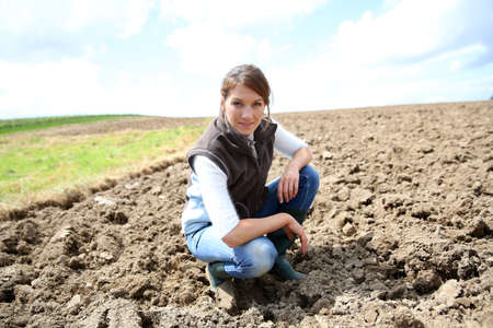 Farmer woman standing on farming land photo