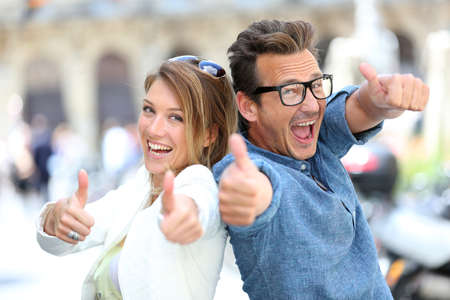Funny couple showing thumbs up to camera Stock fotó