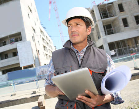 Entrepreneur on building site using tablet photo