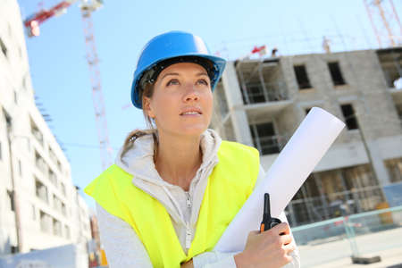 woman engineer: Portrait of woman engineer working on building site