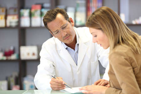 Veterinarian giving medical advice to client photo