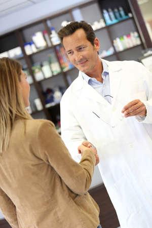 medicalcare: Veterinarian giving handshake to client