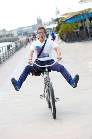 handsome old man: Man having fun riding bicycle Stock Photo