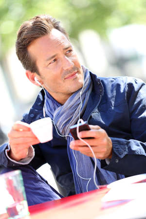 handsfree phone: Middle-aged man talking on phone with handsfree Stock Photo