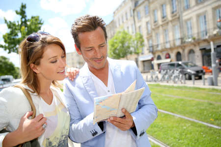 Couple in town looking at public transport map photo