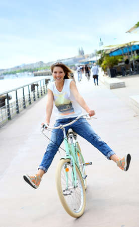 Woman riding bicycle on Bordeaux Docks Stock Photo