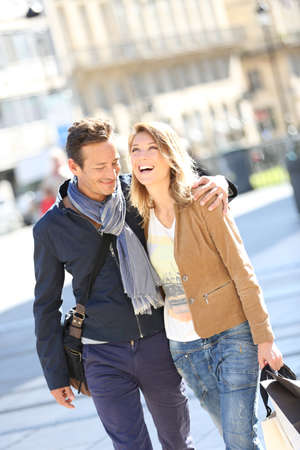 Cheerful couple in town doing shopping photo