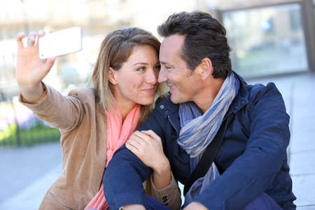 adult couple: Mature couple taking picture with smartphone Stock Photo
