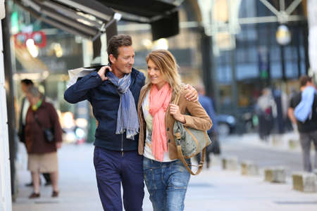 Middle-aged couple doing shopping on week-end photo