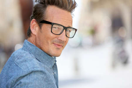 40 year old man: Portrait of handsome 40 year old man with eyeglasses