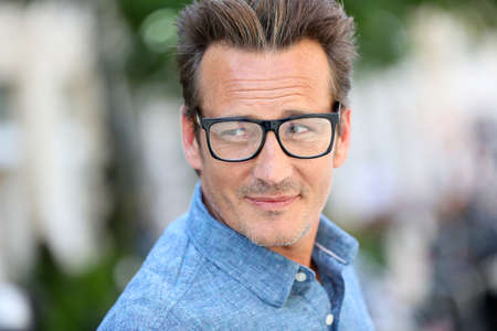 Portrait of handsome 40 year old man with eyeglasses photo