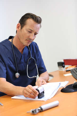 doctor writing: Portrait of doctor writing medical prescription Stock Photo