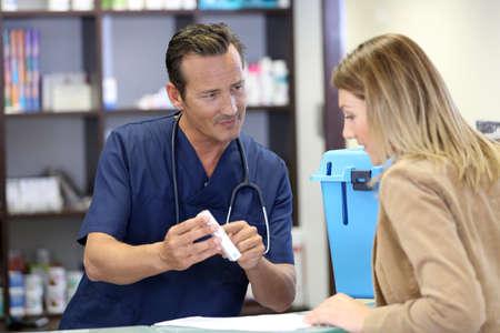 medicalcare: Veterinarian giving medical prescription to client