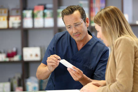 Pharmacist giving information on medicine photo