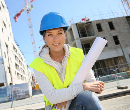 Portrait of woman engineer working on building site photo