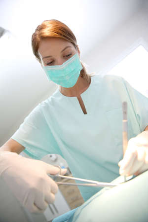 medicalcare: Surgeon woman with mask in surgery room
