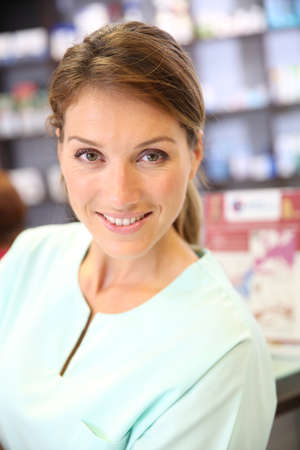 medicalcare: Portrait of smiling pharmacist woman in drugstore Stock Photo