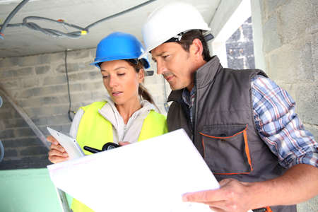 building site: Engineers on building site checking plans