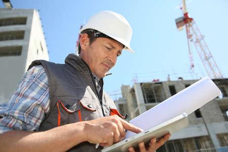 Entrepreneur on building site using tablet photo