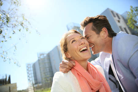 Portrait of mature loving couple enjoying sunny day photo