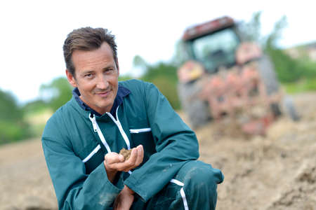 Farmer checking on cultivated ground quality Stock Photo - 28837887