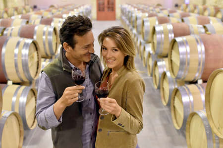 Oenologists in wine cellar tasting red wine Stock Photo