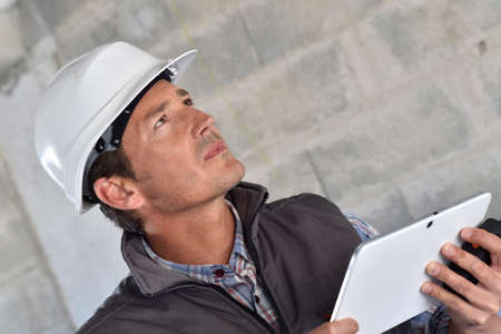 Construction manager using tablet on building site Stock Photo - 28837813