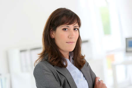thirty: Smiling young businesswoman looking at camera