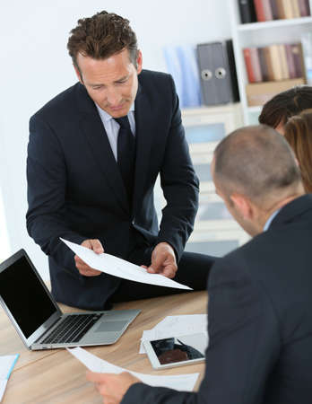manager team: Manager having a meeting with business team