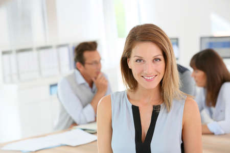 30 40: Portrait of beautiful woman attending business meeting Stock Photo