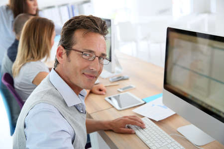 Attractive 40-year-old man in business training photo