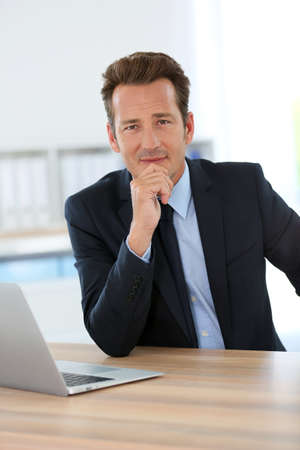 Businessman in office meeting business partner photo