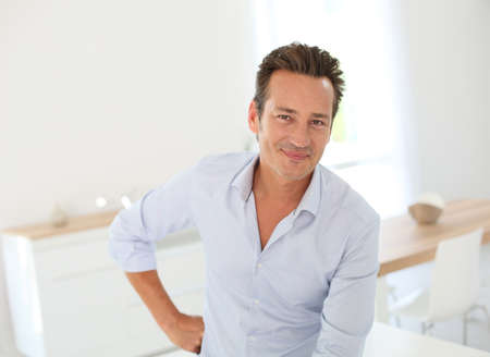40s adult: Portrait of handsome man standing at home