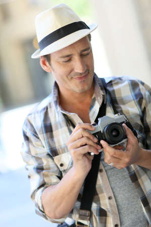 reportage: Photographer in town doing a photo reportage