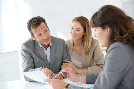 financial planner: Couple meeting financial adviser for loan granting