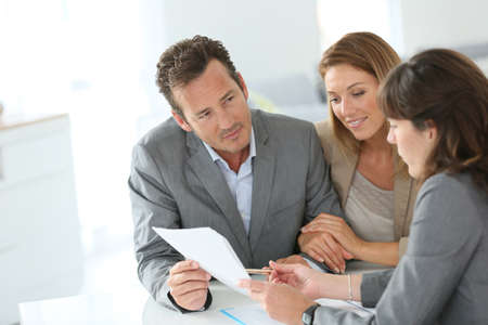 financial adviser: Couple meeting financial adviser for loan granting