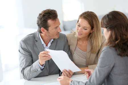 granting: Couple meeting financial adviser for loan granting