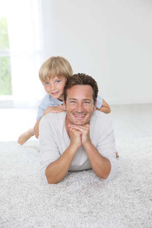 Portrait of cheerful man with 7-year-old son photo