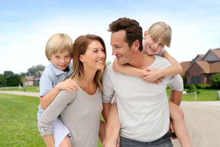 neighborhood: Parents and children standing in neighborhood Stock Photo