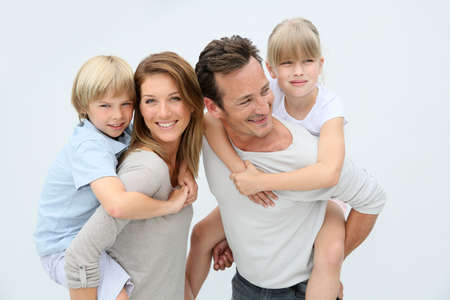 white background: Parents giving piggyback ride to kids Stock Photo